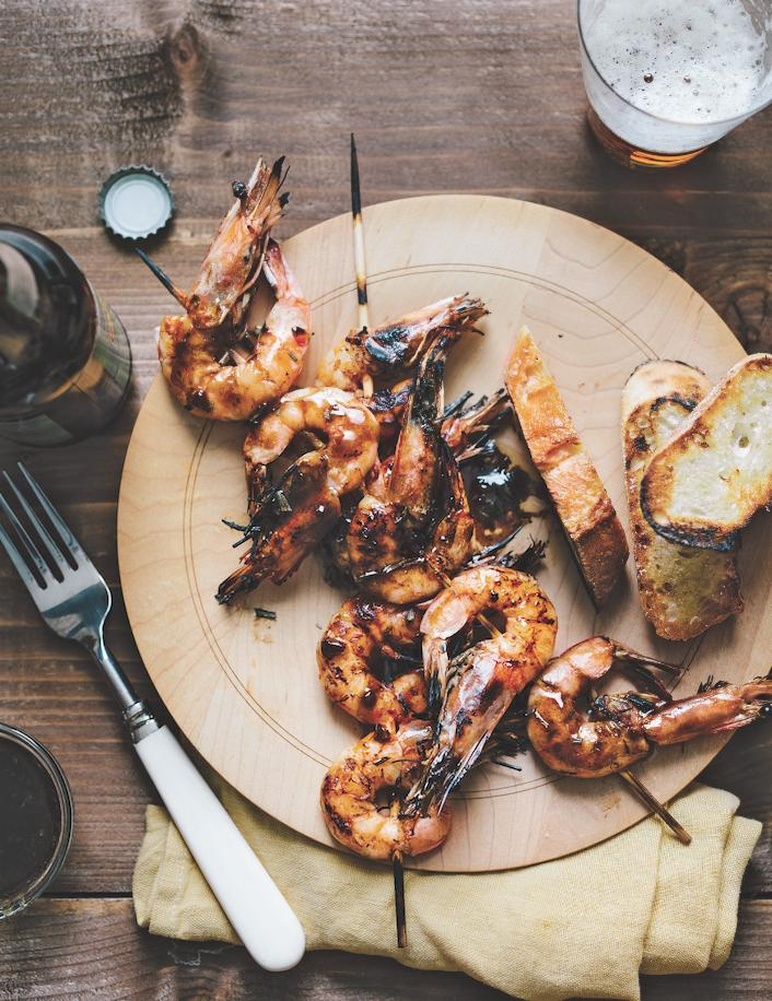 Happy #NationalShrimpDay! Grab a copy of @ChefDavidGuas' cookbook, #GrillNation, at Bayou Bakery today and cook up some of the tastiest shrimp dishes y'all have ever had before! Cook like a pro and make Guas' Grilled Head-On New Orleans-style BBQ Shrimp...