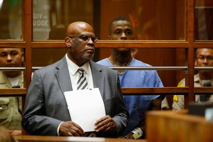 Chris Darden withdraws as Eric Holder's attorney