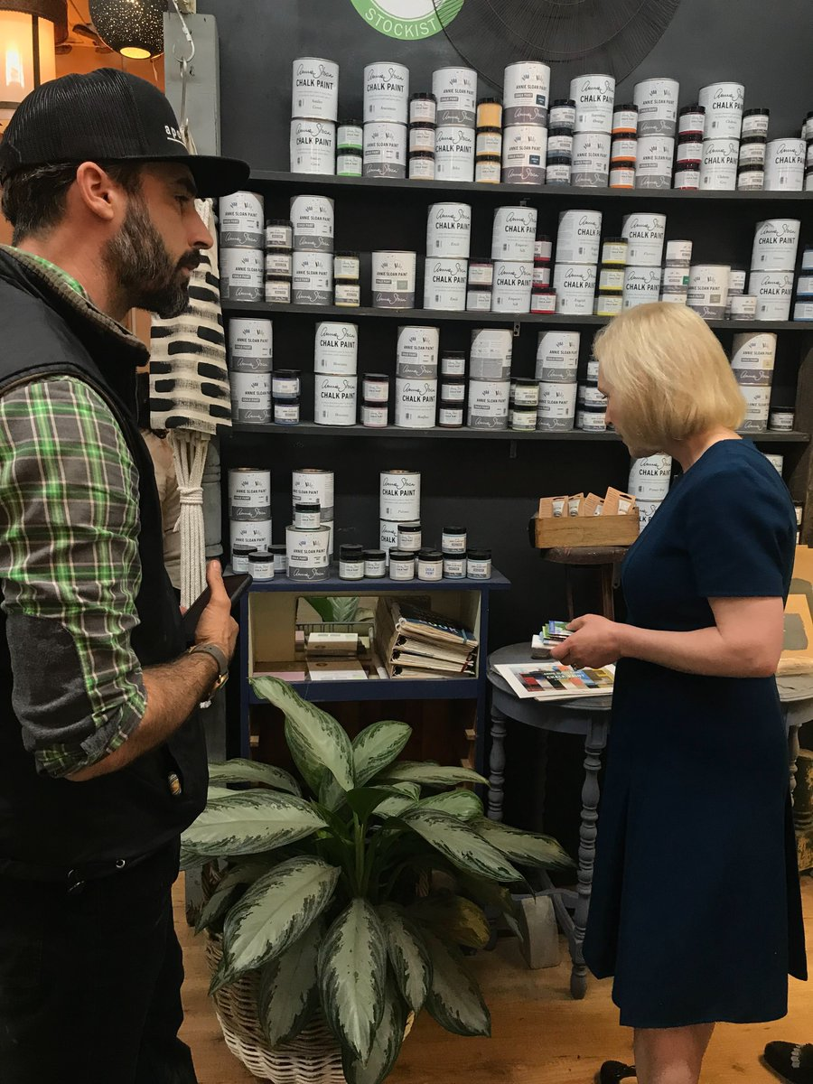 Kirsten Gillibrand peruses gifts for sale at a cafe in Goffstown, NH.