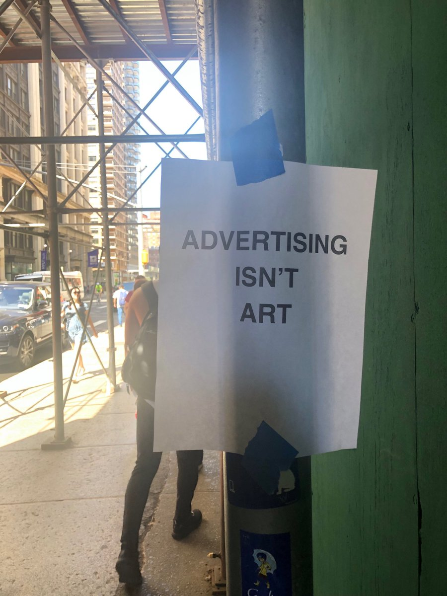Watched the construction guys post this after painting over (illegal) ads posted on their site