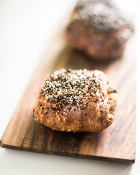 Every Monday-Thursday, we're serving up the popular Everything Croissant, a delightfully flaky pastry topped with a special everything bagel seasoning!