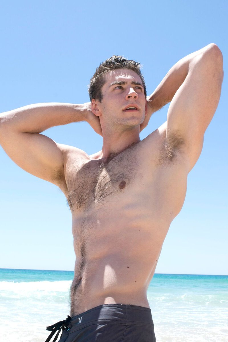 Topless young man is demonstrating his torso