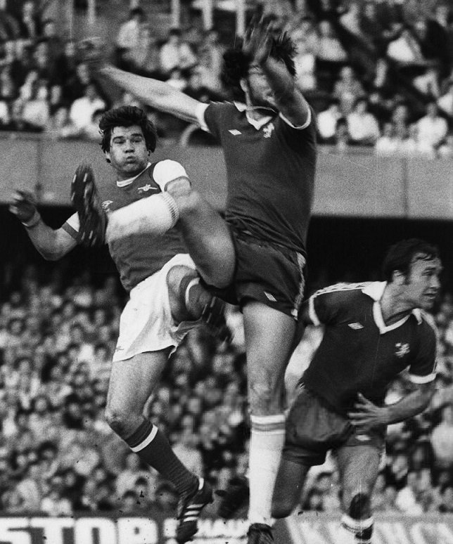 Footballing commitment - Supermac in battle with big Micky Droy ...