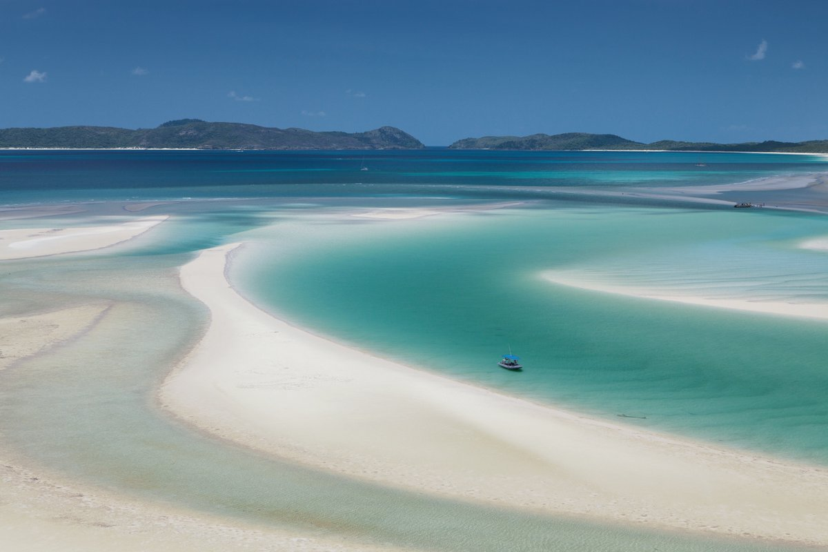 Hidden within the quiet Whitsunday Islands is Whitehaven Beach. Wade through crystal clear water and admire the pure-white sand at your feet #swaindestinations #australia