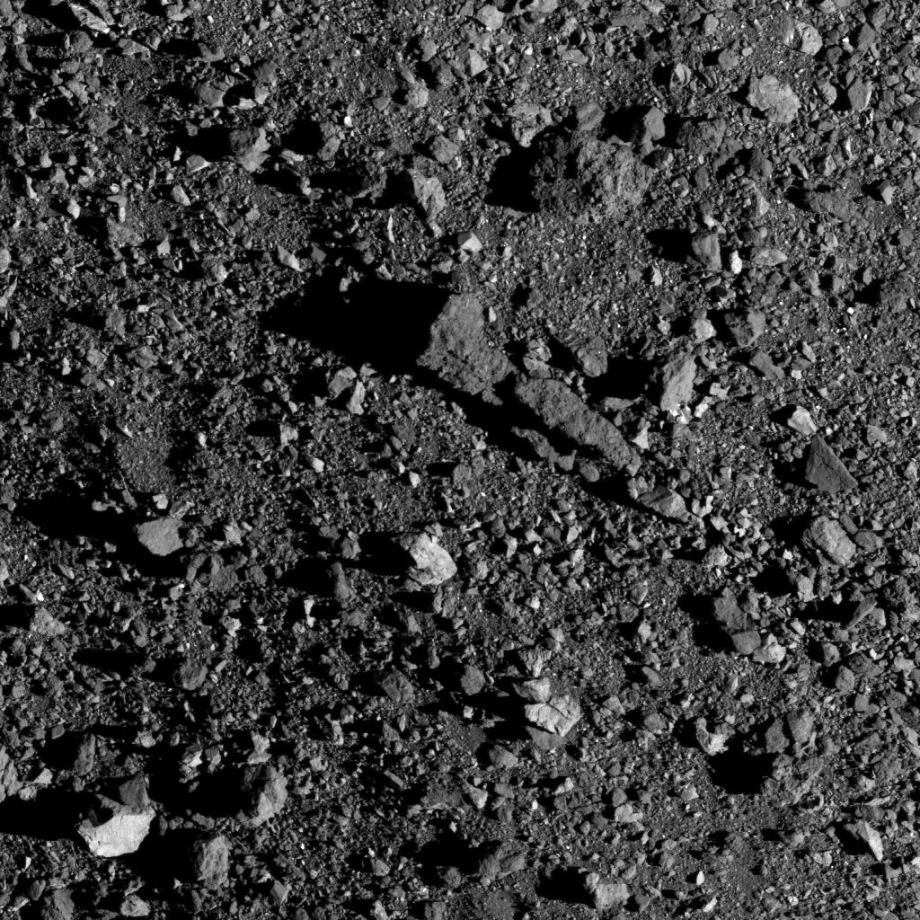 This long, almost triangular boulder formation casts a long shadow in asteroid Bennus early morning sunlight. The boulder is 62 ft (18.9 m) in length, which is about the length of a bowling lane. (Unsure if @USBC would consider it regulation, though.) bit.ly/2LMTe1E