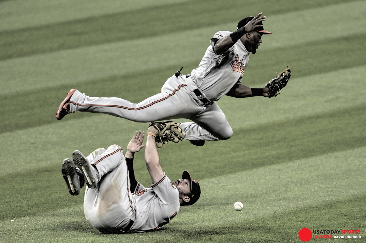 Baltimore Orioles second baseman Hanser Alberto and right fielder Trey Mancini collide in the outfield against the Cleveland Indians at Progressive Field. <br>http://pic.twitter.com/7cUm9ytOXX