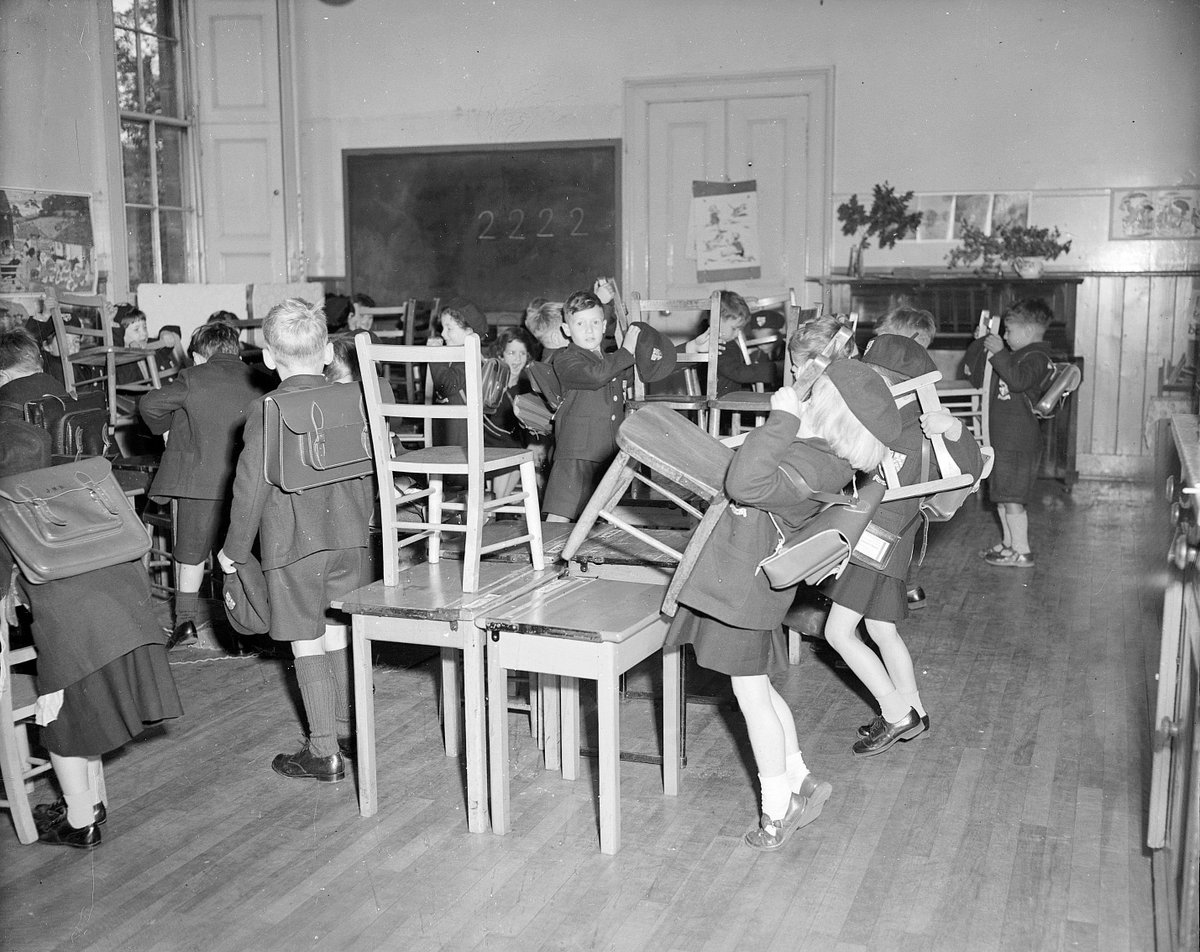 Fast forward some 214 years to this archive image showing children putting their chairs on their desks at the end of their first day at George Watsons School in 1955... (© The Scotsman Publications Ltd. Licensor @Scranlife)