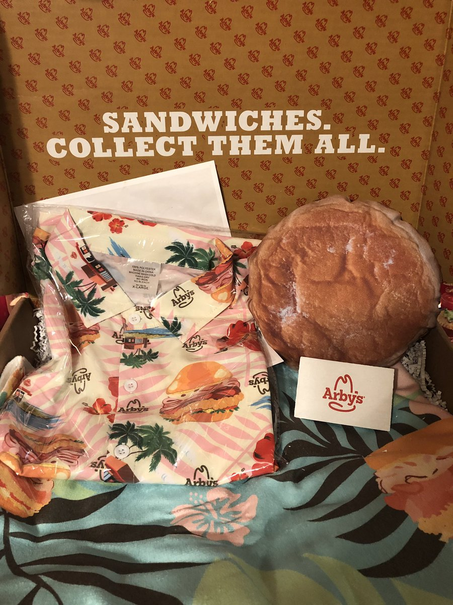 Omg yas!! This month's @arbys of the Month Club box came with a Hawaiian shirt, beach towel, throw pillow and of course, a gift card.
