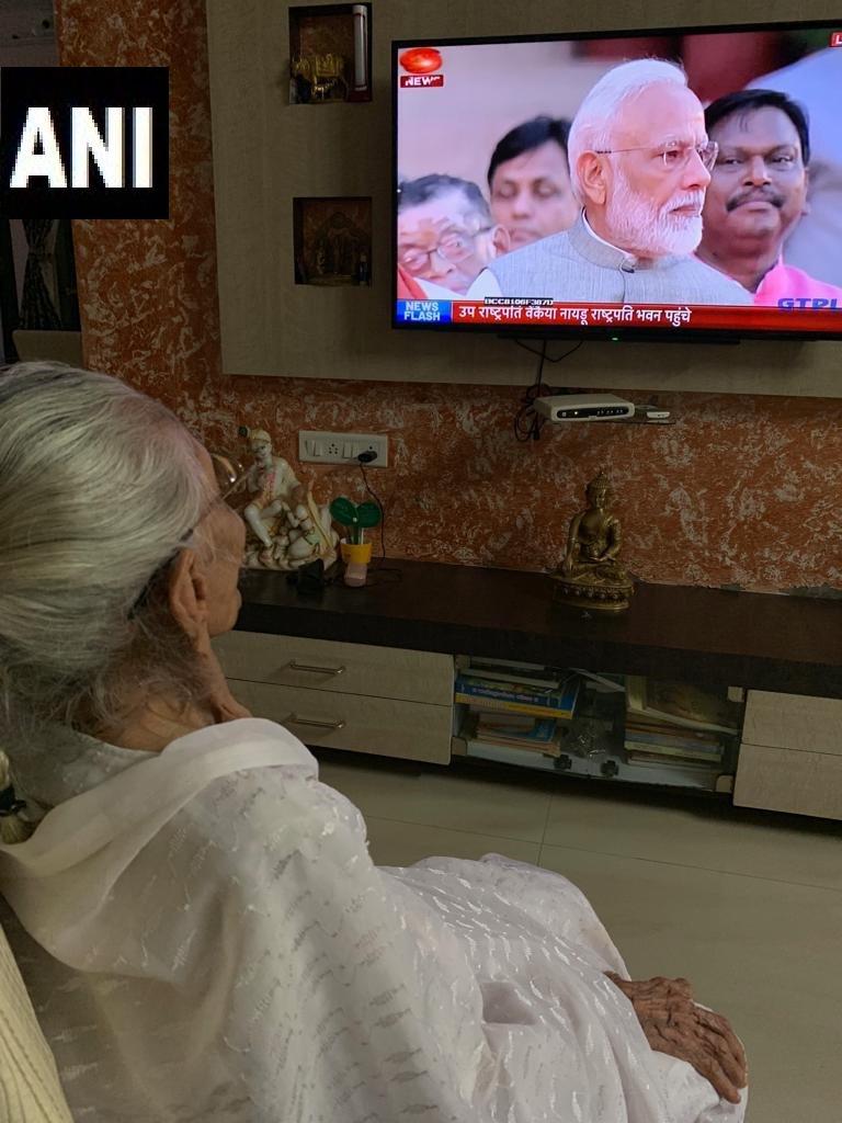 Ahmedabad: Heeraben Modi, mother of PM Narendra Modi watching the swearing in ceremony