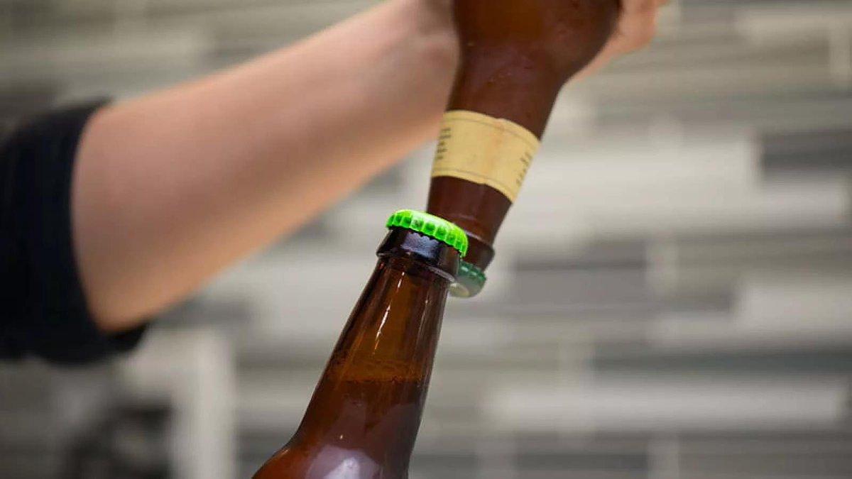 Milf masturbating with beer bottle