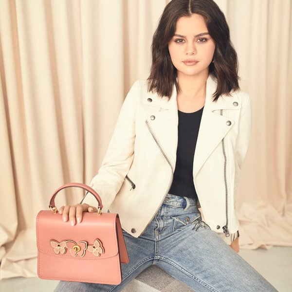 We're all aflutter. With her Parker Top Handle in pink and Biker Jacket in white, #SelenaGomez floats like a butterfly and stings like a bee. #CoachNY  http://on.coach.com/TheSummerPicks