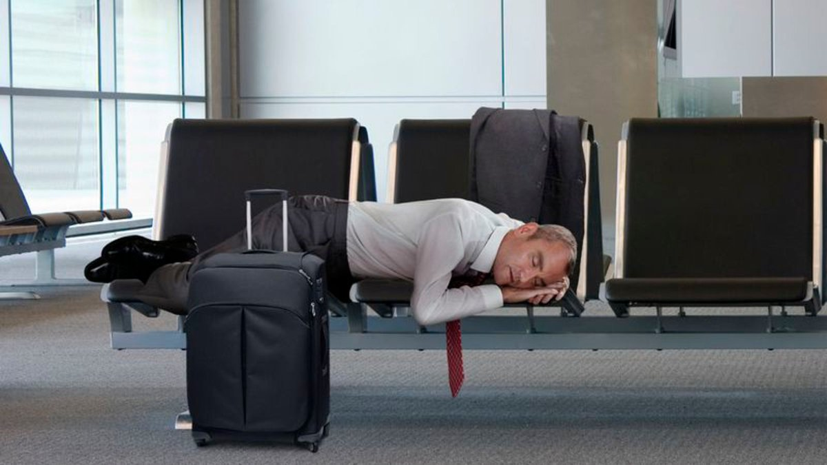 Sleeping Middle-Aged Businessman In Airport Suddenly So Childlike, So Vulnerable https://trib.al/4gkjb6H
