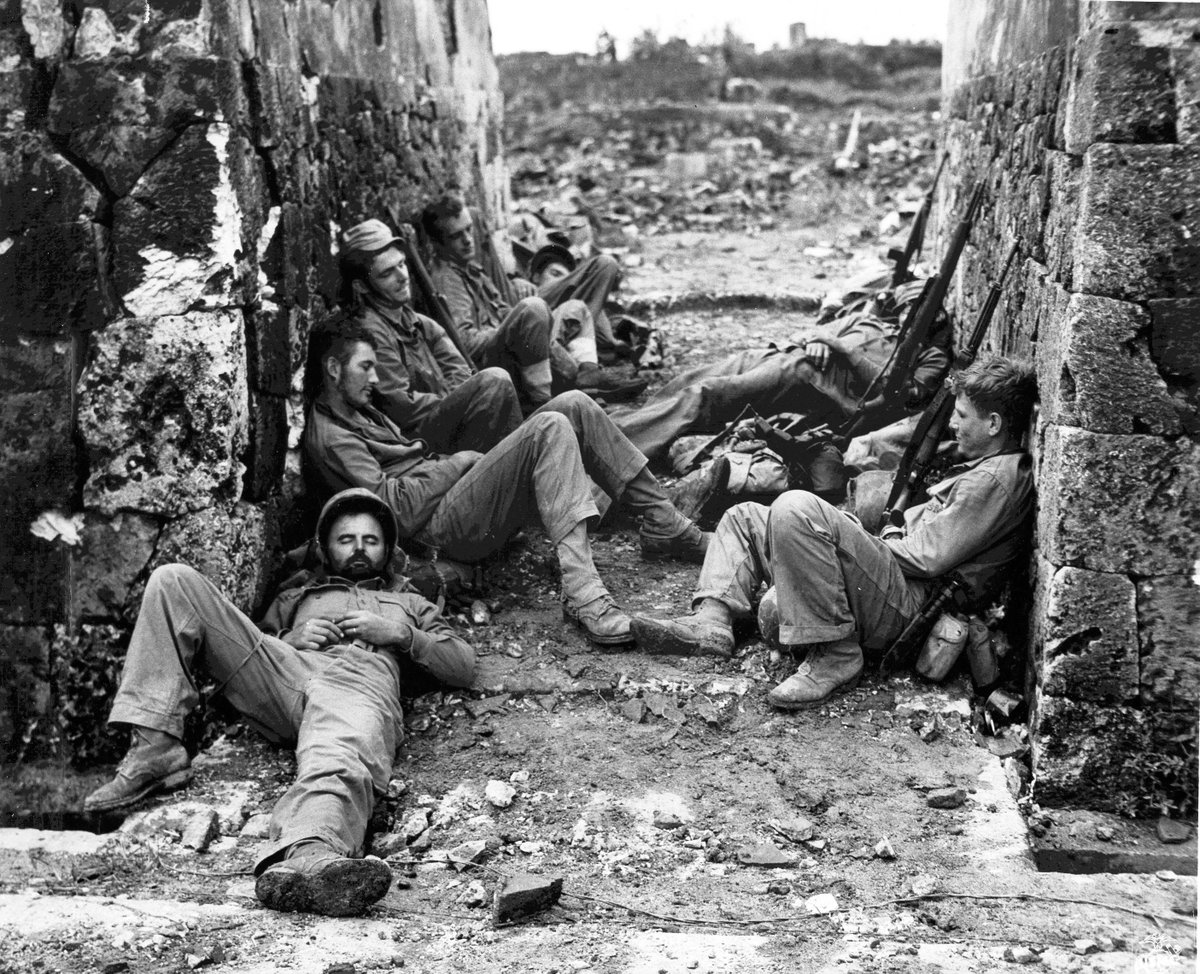 Men of U.S. 6th Marine Division resting in Naha, Okinawa, on May 29, 1945. #History #WWIIpic.twitter.com/lbrTAZL50A