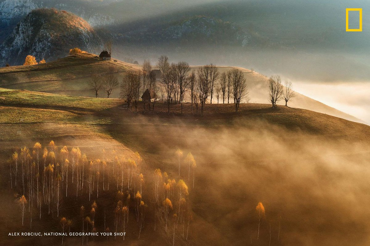 """""""This location is situated in Apuseni, a mountain range in Romania,"""" writes #YourShotPhotographer Alex Robciuc. """"It has some nice and unique elements: scattered old abandoned sheppard's huts, small clumps of birch trees, and gently rolling hills."""" on.natgeo.com/2QexEC3"""