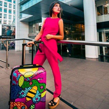 Girl with Mia Toro Allegra luggage