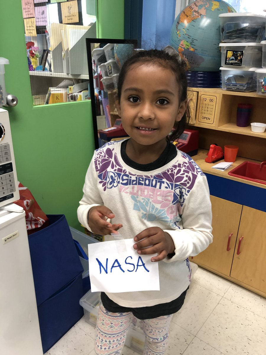 Kindergarten student decorating her classroom with NASA patch stickers she made before school! <a target='_blank' href='http://search.twitter.com/search?q=NASAedu'><a target='_blank' href='https://twitter.com/hashtag/NASAedu?src=hash'>#NASAedu</a></a> <a target='_blank' href='http://search.twitter.com/search?q=NASAspirit'><a target='_blank' href='https://twitter.com/hashtag/NASAspirit?src=hash'>#NASAspirit</a></a> <a target='_blank' href='http://search.twitter.com/search?q=KWBPride'><a target='_blank' href='https://twitter.com/hashtag/KWBPride?src=hash'>#KWBPride</a></a> <a target='_blank' href='http://twitter.com/KWBwelsh'>@KWBwelsh</a> <a target='_blank' href='http://search.twitter.com/search?q=NASAExplorerSchool'><a target='_blank' href='https://twitter.com/hashtag/NASAExplorerSchool?src=hash'>#NASAExplorerSchool</a></a> <a target='_blank' href='https://t.co/vbJjB5t0mF'>https://t.co/vbJjB5t0mF</a>