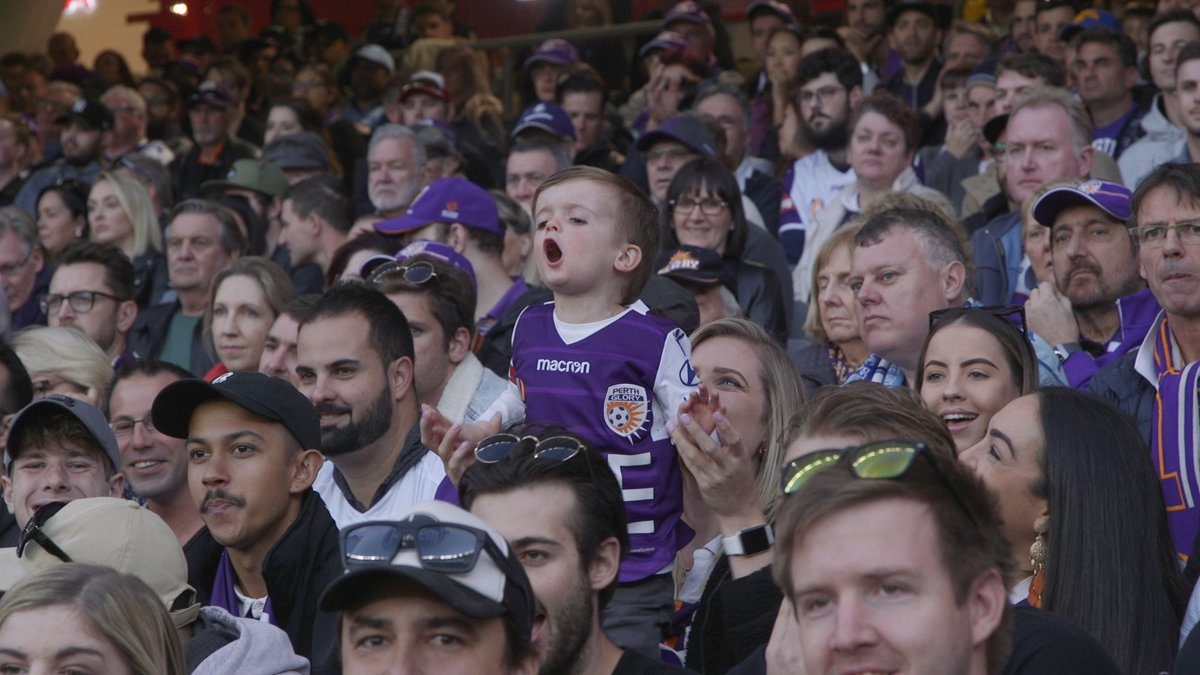 In full voice! A young Glory fan gets right behind the team at Sunday's Grand Final. @ALeague @OptusStadium #OneGlory