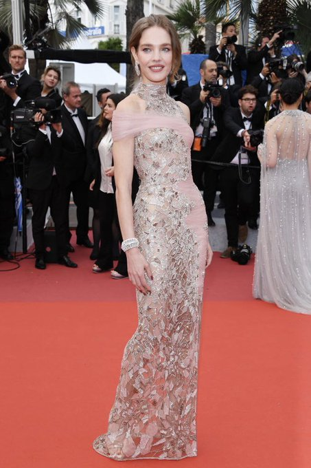 """84a686564ec  NataliaVodianova arrives to the screening of """"La Belle Époque"""" at the 2019  Cannes Film Festival in an  AtelierVersace gown enriched with Swarovski  crystal ..."""