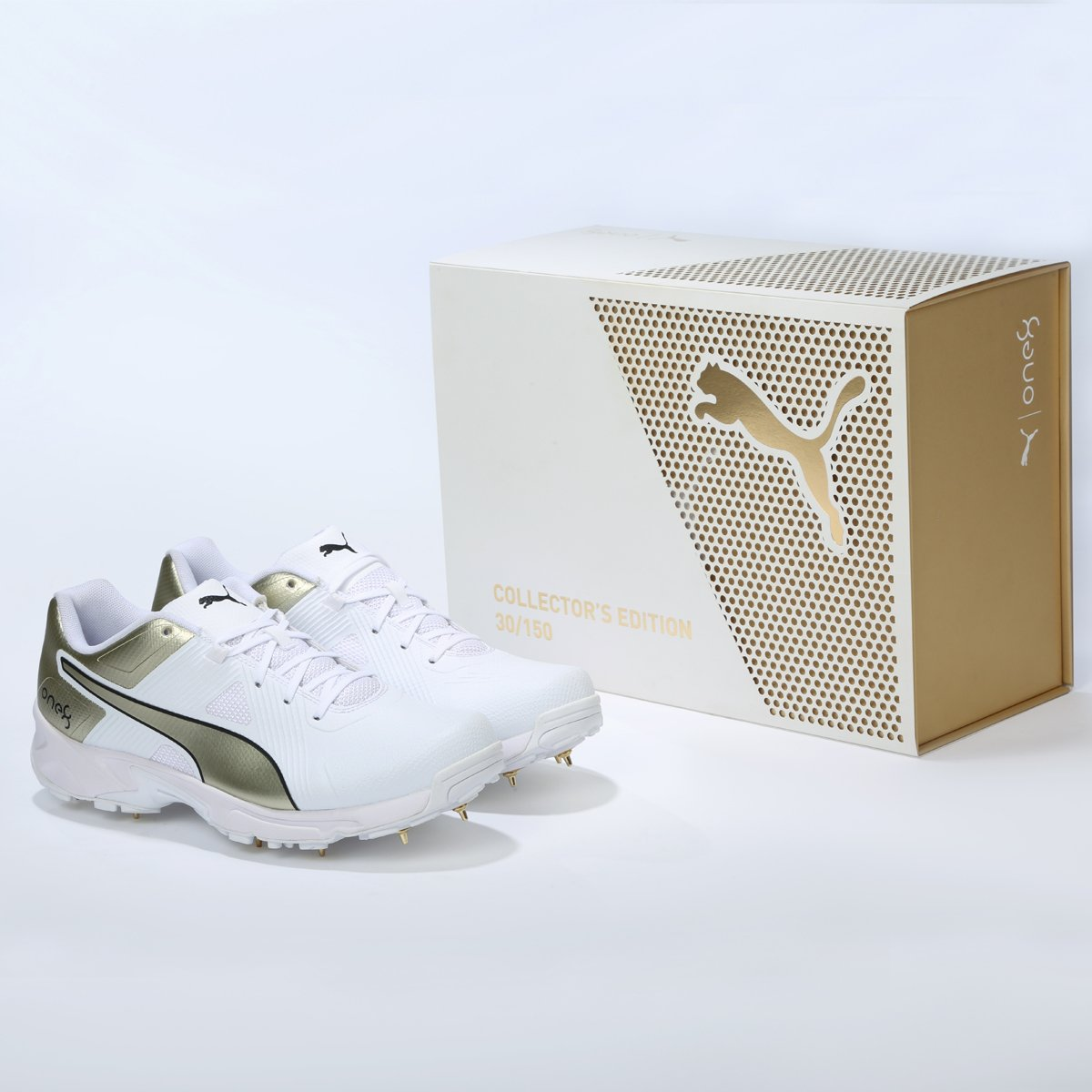 puma one8 gold spikes price Shop