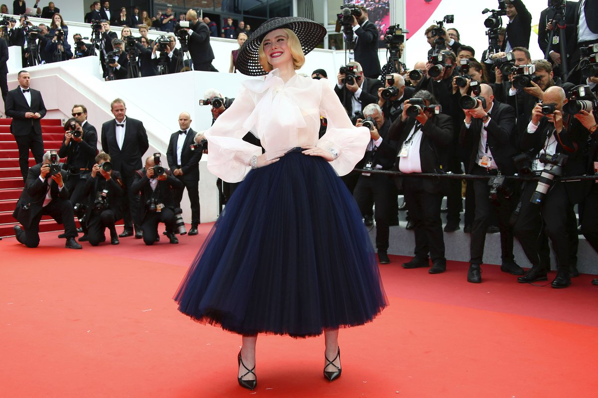 PHOTO GALLERY: #ElleFanning arrives at the premiere of #OnceUponATimeInHollywood at #Cannes2019  in southern France on Tuesday. (Photos by Joel C Ryan/Invision/AP) <br>http://pic.twitter.com/m6IyxgczXW