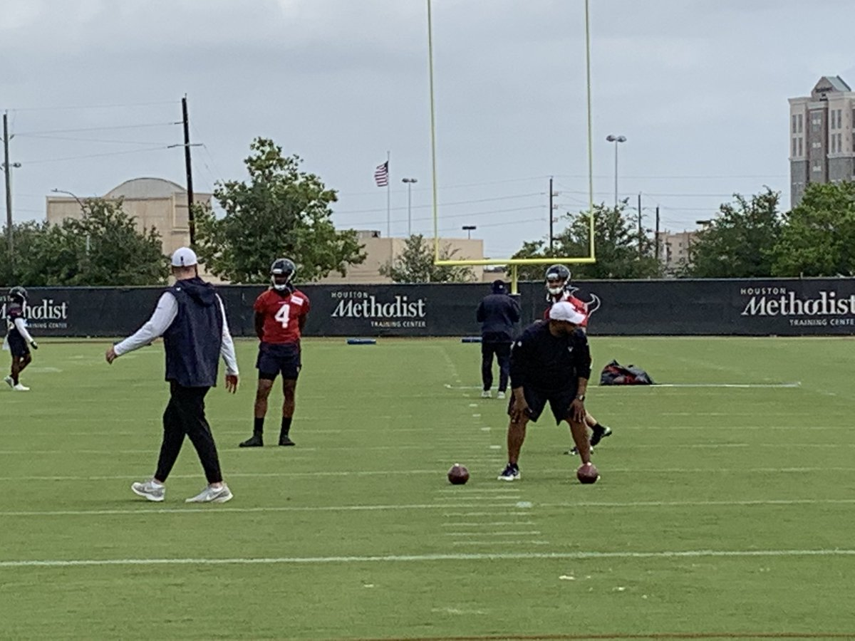 The #Texans are opening OTAs today. Here's new OC Tim Kelly with Deshaun Watson and AJ McCarron. <br>http://pic.twitter.com/qD6WPSTK9f