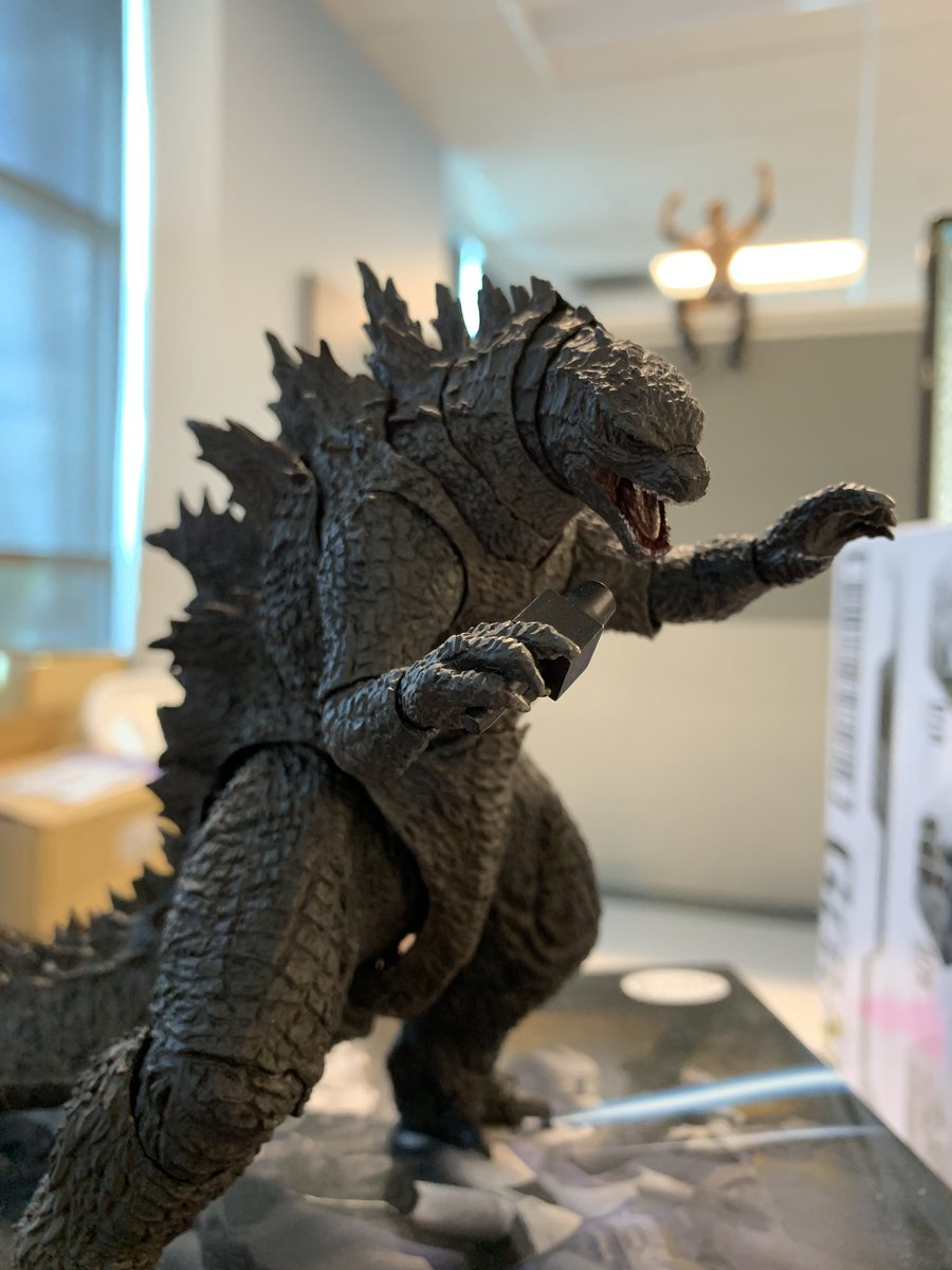 "Random work thought, ""Can Godzilla hold the Rock's microphone?"" The answer is an amazing yes!!! Eat your heart out Celine Dion. <br>http://pic.twitter.com/5S0r71qnnq"
