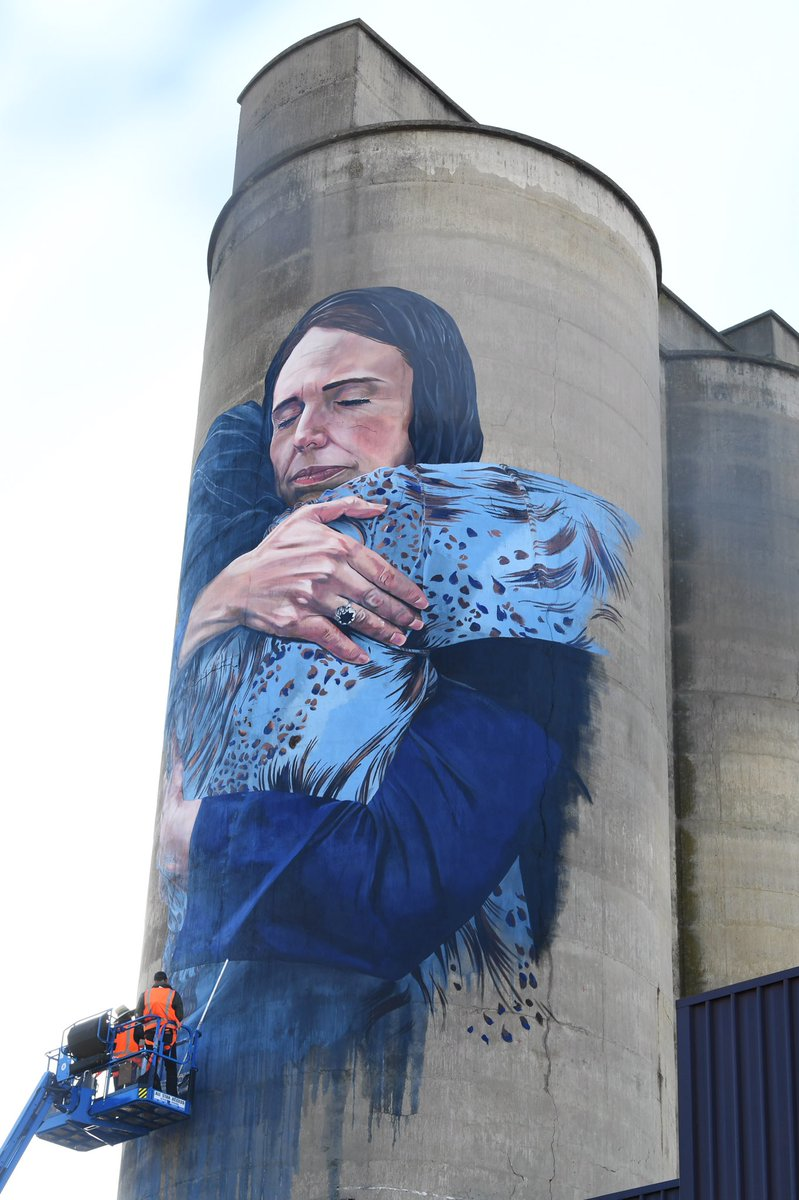 The mural on a silo in Brunswick, Melbourne, depicting New Zealand PM Jacinda Ardern embracing a Muslim woman in the wake of the Christchurch massacre is complete. It is by street artist Loretta Lizzio.  : AAP <br>http://pic.twitter.com/SgiHtZDylY