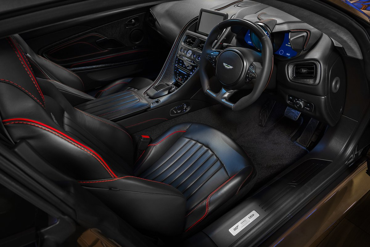 On the inside, the DBS Superleggera is adorned in pure black leather, accented by grey blend Alcantara, as in the original 1969 DBS. The cockpit is accented in red, inspired by the red trimmed glovebox in the original car.  #JamesBond #007 #AstonMartin
