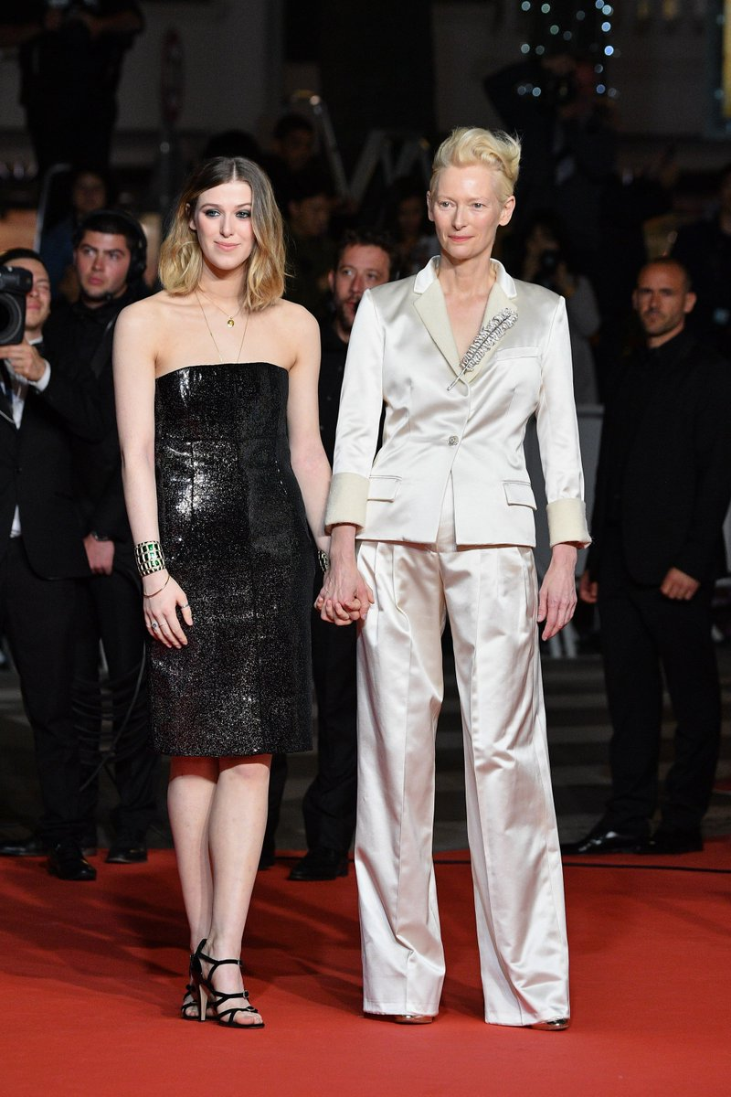 "Tilda Swinton wore a #CHANEL Fall 2019 satin suit + #ChanelFineJewelry and Honor Swinton Byrne wore a #CHANEL Fall 2017 embroidered bustier dress and heels to the ""Parasite"" premiere at the 2019 Cannes Film Festival. #Cannes2019"