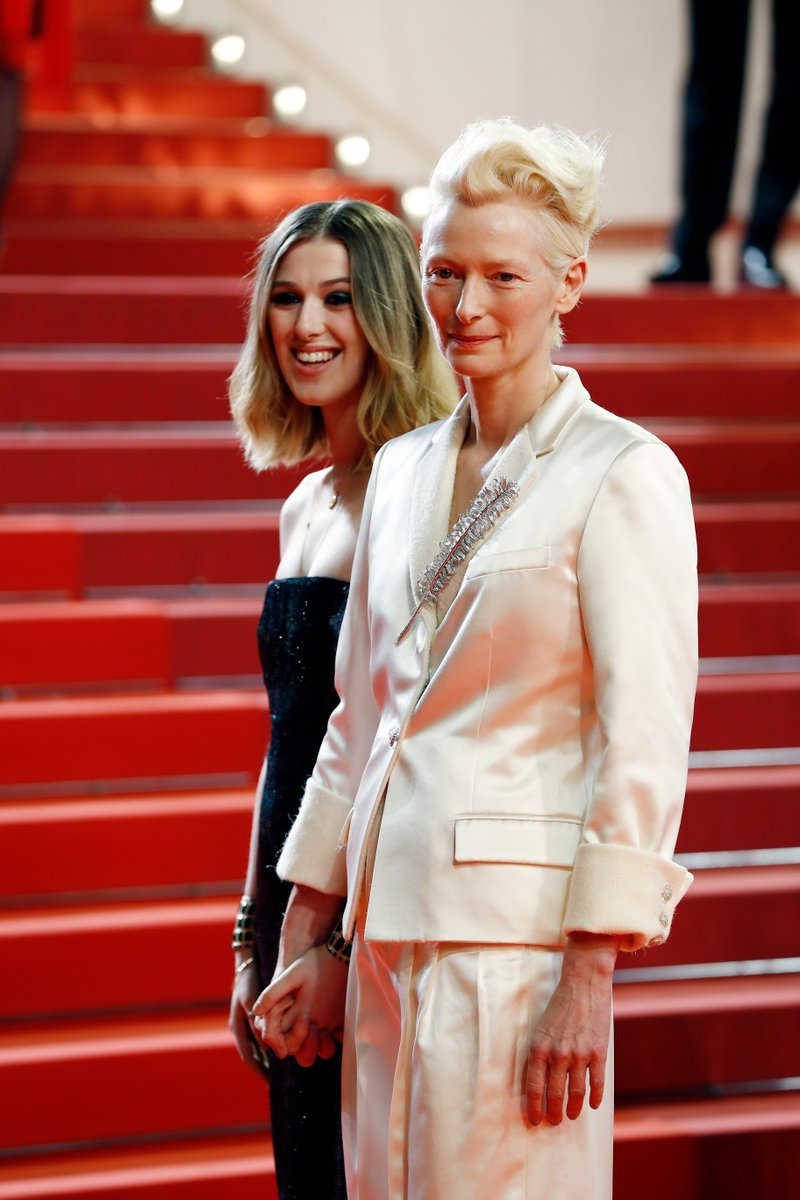 #CHANELinCannes — House ambassador Tilda Swinton and Honor Swinton Byrne in the CHANEL suite before stepping out on the red carpet in #CHANELFallWinter for the #Cannes2019 screening of 'Parasite'. #CHANELinCinema More on http://chanel.com/-T_Cannes19