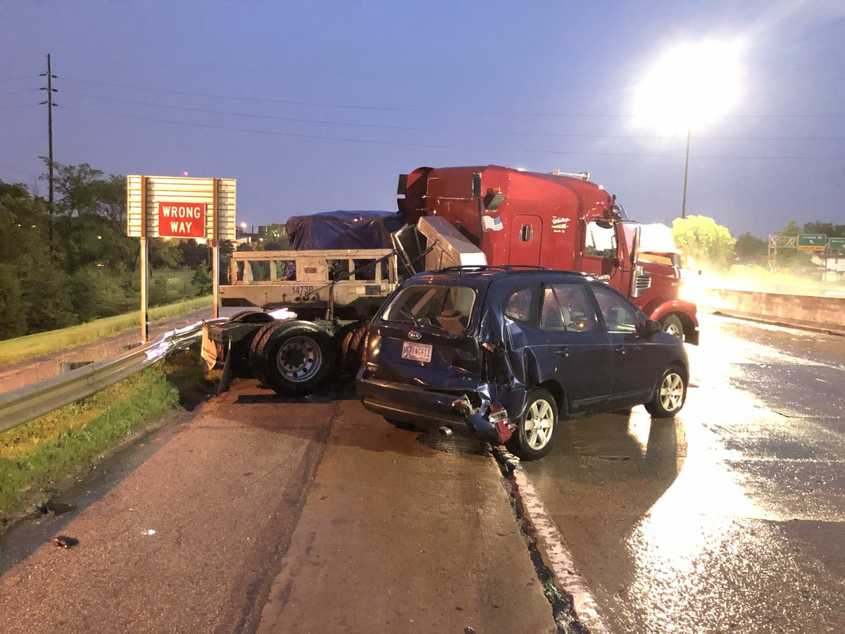 I-70 WB near MERIDIAN ST: ISP tells me no one was injured after a semi driver lost control after hiting standing water in the far left lane, jackknifed, &amp; collided w/ 2 cars (1 unoccupied). 2 right lanes blocked, giant puddle still in left lane. #NewsTracker #Daybreak8 <br>http://pic.twitter.com/rdOzLJHvfn