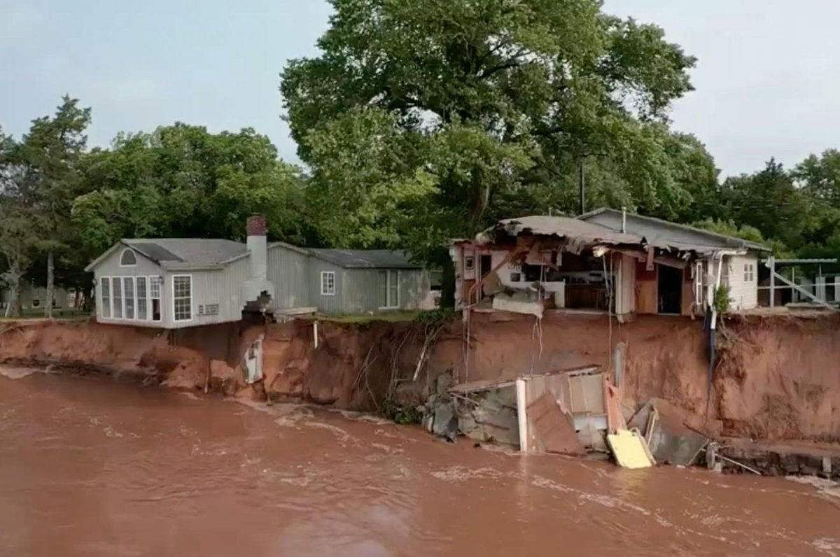 These houses are dangling over a swelling river outside Oklahoma City cnn.it/2VWth4o