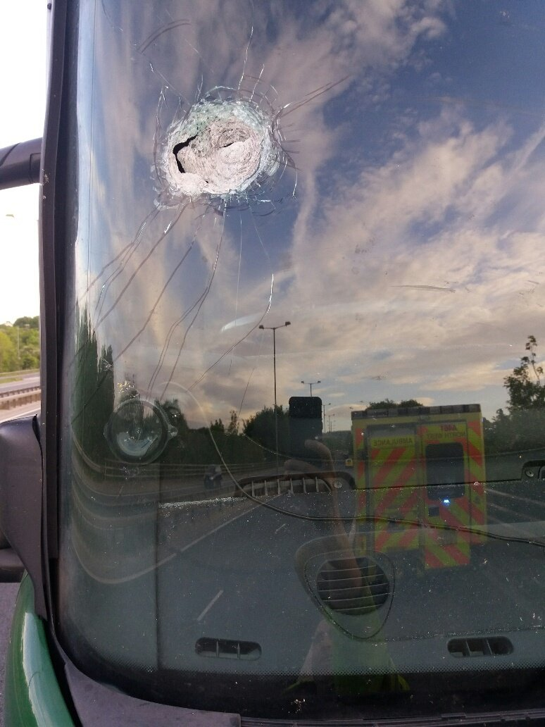 This driver going about his business on the M66 when a heavy object is dropped from an overhead bridge. This resulted in the  driver having glass in his eye and an injury to his chest. .................Parents where are your children?