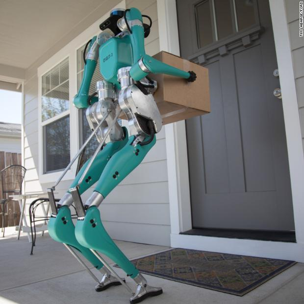 This human-like robot can climb steps, walk on uneven terrain and stay balanced even if it's bumped. Ford is testing the robot, called Digit, with the goal of having it carry deliveries from self-driving cars to customers' doorsteps. https://cnn.it/2W2SoTd