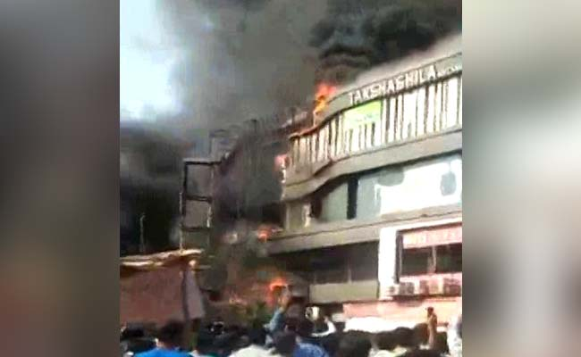 #SuratFire: The fire station was just 2 km away but the fire spread rapidly, before it could be controlled. Chief Minister Vijay Rupani has ordered a probe into the incidentRead more here: https://www.ndtv.com/india-news/huge-fire-at-multi-storey-building-in-surat-18-fire-engines-at-the-spot-2042615…