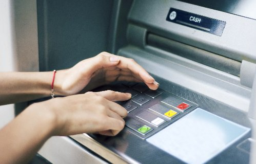 Before inserting your card, pull on the card reader to ensure it is secure, cover your hand while entering your PIN and closely monitor your transactions.