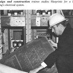 A GSA design and construction trainee studies blueprints for a federal building's electrical system, circa 1960s. #FedBldgFridays #GSAat70