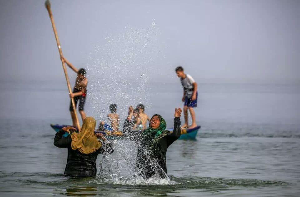 Gazans head to the sea to escape the heatwave.