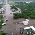 Image for the Tweet beginning: Drone footage shows Oklahoma town