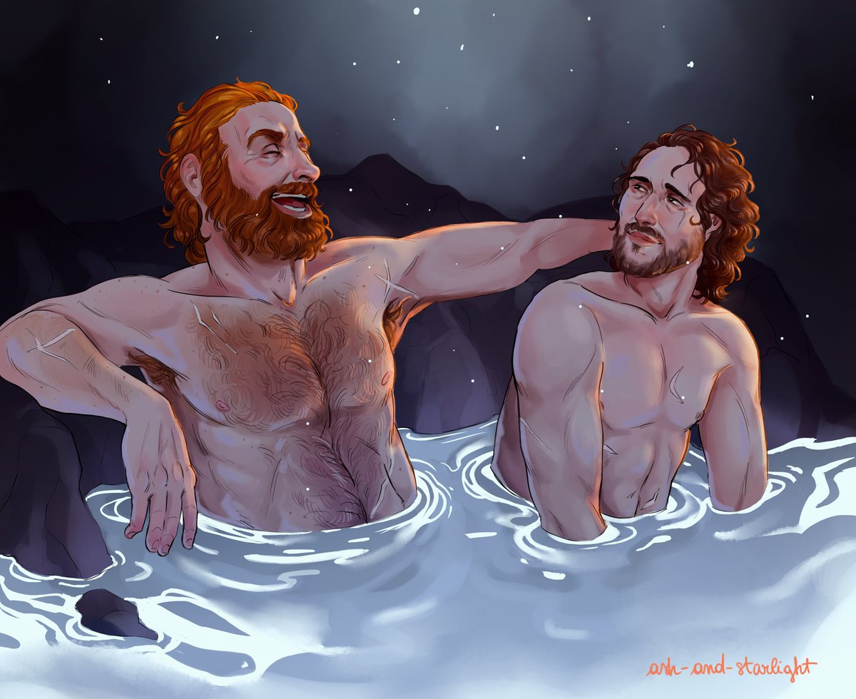 Two bros sitting in a hot spring