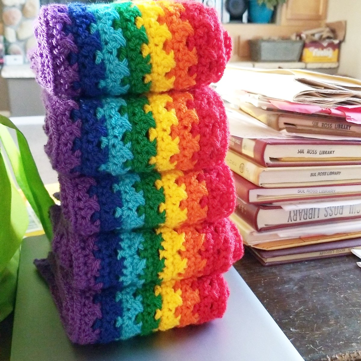 There is something satisfactory about a pile of rainbow scarves being taller than a pile of books. I'll have at least one more scarf finished before bed. 🌈  #rainbowscarf  #rainbowlove  #rainbow🌈 #paintboxyarns  #paintbox  #loveknittingcom  #crochetscarf #day145of365