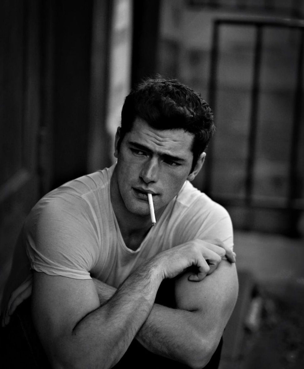 Sean O'Pry smoking a cigarette (or weed)