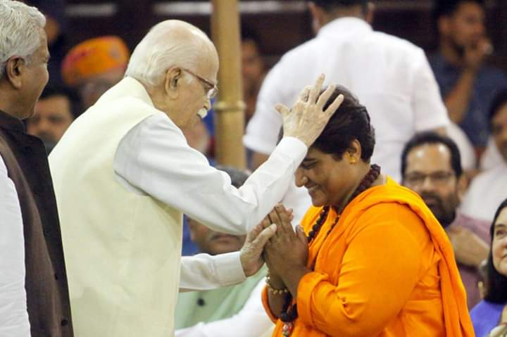 Tweeple, please don't feel sad for Advani. This picture reiterates the fact that he was very much the original hate-monger.