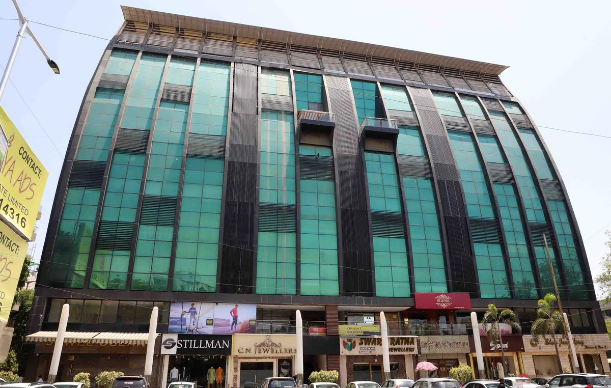 AMC demolishes illegally built roof-top cafe on CG Road, serves final notice for fire NOC to 7 buildings