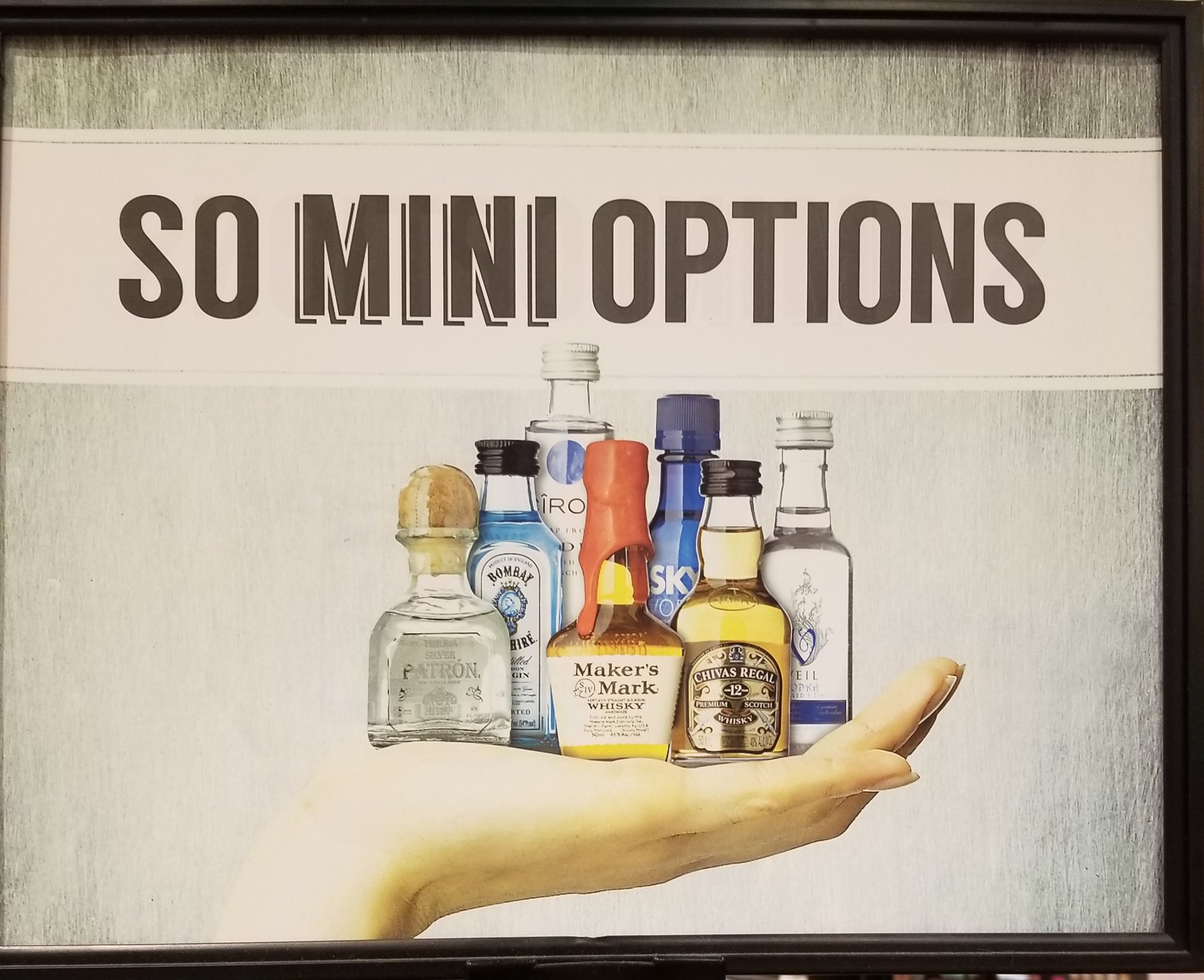 an image of a hand holding small liquors with the text saying So Mini Options