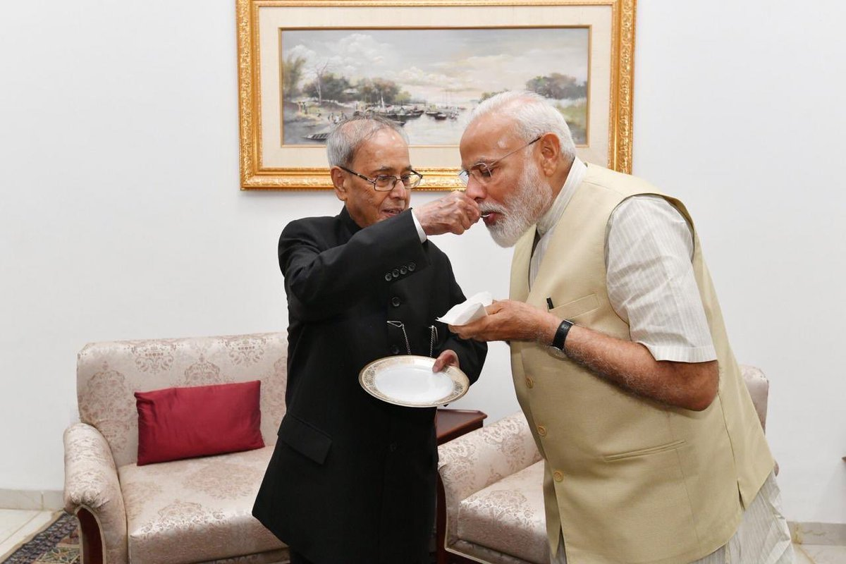 Picture of the day. ❤️ Ex President Pranab Mukherjee welcomes the PM elect Narendra Modi with traditional sweets after his landslide electoral victory. An inner joy which this gesture is clearly reflecting. Indeed a great moment for our democracy. #17thLokSabha #IndiaDecides2019