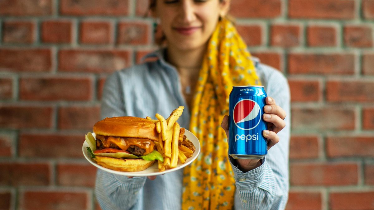 Juicy burger, melty cheese, toasty buns, and the fizzy crack of a Pepsi...best #NationalHamburgerDay ever 🍔