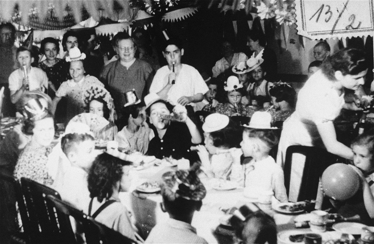 Children aboard the MS #StLouis celebrate after Belgium, France, Great Britain and the Netherlands agree to admit passengers who had been turned away in Cuba. No one could have guessed that the Nazis would later invade three of these countries, taking the lives of 254 passengers.