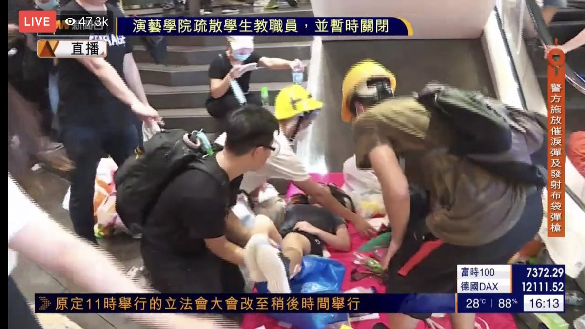 Protesters that attempted to breach LegCo entrance have retreated to CITIC tower lobby where first aid volunteers are attending to injuries, police continue to fire tear gas outside #HongKong