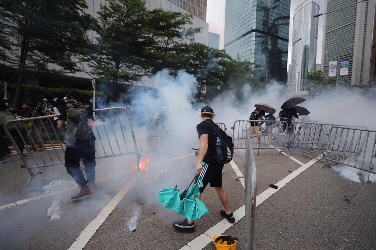 #LIVE: Scenes from the ground as police fire tear gas at Hong Kong protesters, sending crowds running for cover. https://t.co/fpKl8rH1bn #extraditionbill https://t.co/oKPRkdVXAv